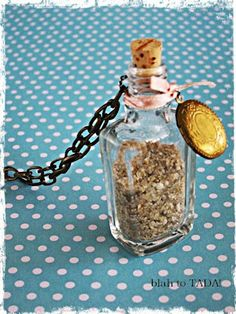 blah: empty nail polish bottle filled with sand & embellished with a cork, locket, ribbon and chain/TADA!: sentimental necklace