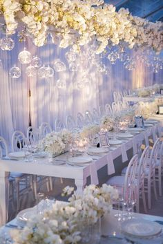 Soft purple wedding decor with overhanging flowers