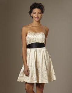 White Strapless Sweetheart Neckline Dress With A Black Belt Around The Waist