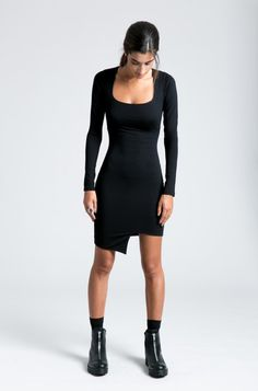 This long sleeve, short pencil dress is chic, original and elegant, yet sexy. The fabric is extremely stretchy, and the lack of a slit on the skirt will help the dress accentuate your silhouette even better. The dress has extra long sleeves and a unique asymmetric bottom hem. MODEL INFO: Sam is XS size, 58 tall (173cm). She is wearing size XS. The design fits true to size.  LENGTH: Approximately 33 inches (84cm.) measured from the shoulder to the shortest part of the bottom hem.  SIZE CHART…