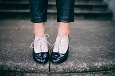 This Kate Spade Heeled Oxford Shoes has a unique twist with its two-toned patent leather and heel.