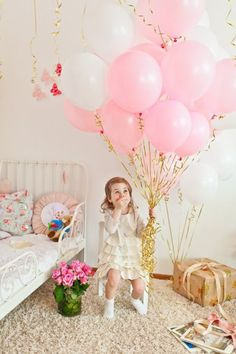 Pink and white balloons with gold tie