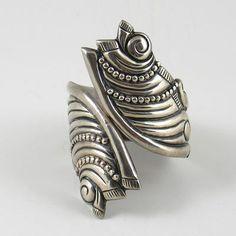 Clamper bracelet   Designer unknown (Taxco).  Sterling silver.  ca.  1940s