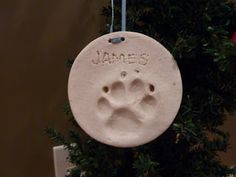 Salt Dough Christmas ornaments of your dogs paw print.  Great idea!  1 cup salt, 2 cups flour, 3/4-1 cup lukewarm water.  Air dry or bake in a 200 degree oven.
