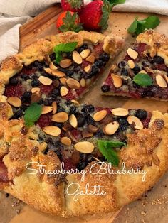 This Strawberry Blueberry Galette starts off with the most delicately sweet, flaky, shortcrust pastry imaginable. It's topped with a luscious layer of frangipane (a soft, sweet almond-flavored french pastry filling) that surrounds and cushions a brilliant layer of strawberries and blueberries. The pastry shell is coated with a crisp sugar crust and the berries are topped with toasted sliced almonds. Yum!?!?!   #mysweettoothbakery #galettes #frangipane #berrytarts Blueberries, Strawberries, Blueberry Galette, Tart Filling, Pastry Shells, Strawberry Blueberry, Shortcrust Pastry, Fresh Mint Leaves, Frozen Fruit