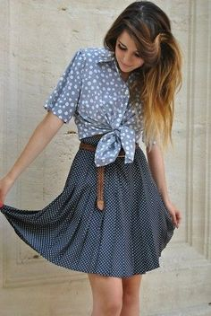 Shop this look on Lookastic:  http://lookastic.com/women/looks/brown-leather-belt-navy-and-white-polka-dot-skater-skirt-light-blue-polka-dot-short-sleeve-button-down-shirt/9627  — Brown Woven Leather Belt  — Navy and White Polka Dot Skater Skirt  — Light Blue Polka Dot Short Sleeve Button Down Shirt