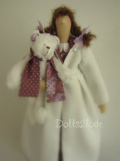 Tilda doll Heather wearing a pink and purple dress and an off white wintercoat accompanied by her little teddy bear, made by Dolls2love on Etsy, €47.50 (sold)