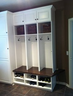 Small mudroom ideas - like the bottom shelves for shoe storage.