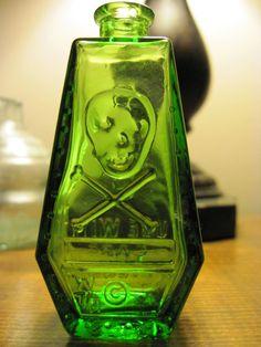 green wheaton antique skull embossed poison bottle
