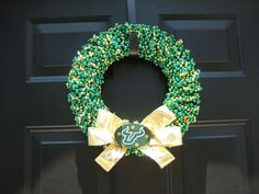 USF Wreath... finally something to do with the millions of green and gold beads i have collected over the years!