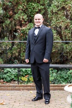 Classic groom outfit idea - black tuxedo and black bow tie {Kate McStay Photography}