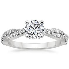 This beautiful nature-inspired diamond infinity engagement ring features delicate strands of diamonds twisting together to create a stunning band. A customer favorite!.