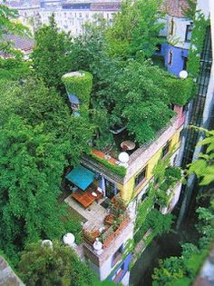 As is gloriously obvious from this aerial view of his HundertwasserHaus in Wien (Vienna), Hundertwasser, artist/architect, was also an ardent environmentalist. Should not all city buildings be required to incorporate lush vegetation like this? I would love to live in a building like this.