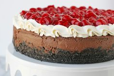 Chocolate Cheesecake with Whippped Cream and Cherries... yum!! - by glorioustreats.com