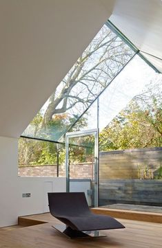 So much glass but how lovely would it be to sit here with your glass of wine and put your feet up!