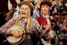 Grangpa Jones and Roni Stoneman on dueling banjos