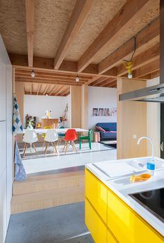 Open plan kitchen dining | Modern kitchen in white and yellow, Eames chair | DNA House BLAF Luc Roymans photography