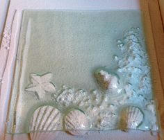 Sample for our fused glass workshop on 13th June. slumped panel using plaster casts, fibre paper and cat litter for texture