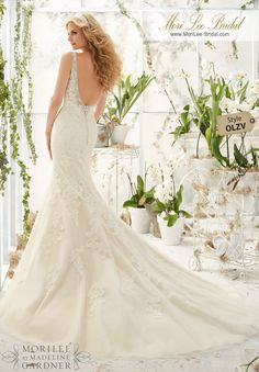 Dress Style OLZV Crystal Beaded Edging Meets The Cascading Alencon Lace Appliques On Net Over Soft Satin  Colors Available: White/Silver, Ivory/Silver, Champagne/Silver