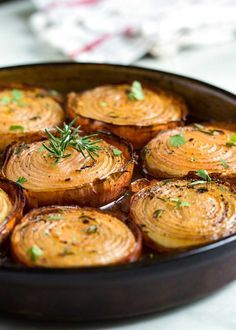 Marinated Slow Roasted Onions are a side dish that are worth you taking a look at. Not your typical side dish like a green bean casserole or a baked potato, these caramelize roasting in a bath of red wine vinegar, brown sugar and spices. Side Dish Recipes, Veggie Recipes, Vegetarian Recipes, Cooking Recipes, Healthy Recipes, Red Onion Recipes, Vegetarian Side Dishes, Green Vegetable Recipes, Vegetable Bake