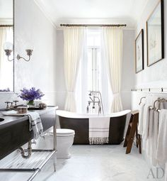 Brooke Shields' bathroom, designed by MADE Architects and David Flint Wood includes a freestanding tub at the window, a custom-designed vanity by MADE, and a Walker Zanger tile floor.