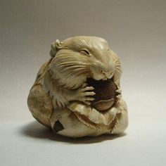 netsuke of rodent eating