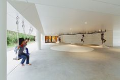 Completed in 2016 in Kagoshima, Japan. Images by Studio Bauhaus, Ryuji Inoue. Akune City where AM Kindergarten and Nursery is located is in northwestern part of Kagoshima Prefecture, and is a port town that has a beautiful. Kindergarten Interior, Kindergarten Design, Cultural Architecture, Education Architecture, Gym Architecture, Japanese Architecture, Nursery Pictures, Kagoshima, Indoor Playground