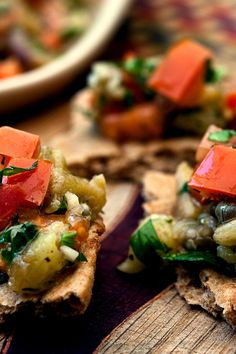 NYT Cooking: Here is a deeply flavored salad that can be prepared entirely outdoors, keeping the heat out of the kitchen. Grill a whole fat purple globe eggplant until the skin blisters. Then scrape the soft insides into a bowl and season them with red wine vinegar, garlic, good olive oil and fresh herbs. A few capers on top add a pleasing brininess. Serve it with pita bread,%2...