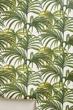 palm tree leaf wallpaper, this would look lovely in an alcove of an all white room. With silver details