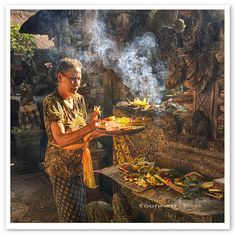 Morning Prayer, Ubud, Bali, give offering in front their house