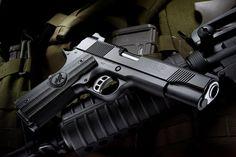 Nighthawk Custom GRP Global Response Pistol .45 ACP 1911 HandgunLoading that magazine is a pain! Get your Magazine speedloader today! http://www.amazon.com/shops/raeind