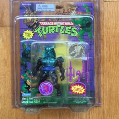 TMNT WARRIOR CHROME DOME 1995 MOC Ninja Turtles Playmates Toys action figure, with GOLD COIN and PURPLE WEAPONS, directly from the Peter Laird's own Mirage Studios Archives, signed by Peter Laird.