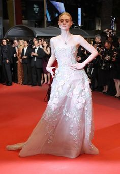 """Elle Fanning Photos - US actress Elle Fanning poses as she arrives on May 20, 2016 for the screening of the film """"The Neon Demon"""" at the 69th Cannes Film Festival in Cannes, southern France.  / AFP / Valery HACHE - 'The Neon Demon'- Red Carpet Arrivals - The 69th Annual Cannes Film Festival"""