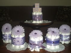 Pink and Purple Baby Shower Centerpieces Diaper cakes other sizes and colors too. $9.50, via Etsy.