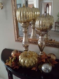 Fall Decor ~ The Mercury Glass Pumpkins are by Valerie on QVC they light up. The Mercury Glass Pedestals and Orbs are finds from a local discount store. Faux fall foliage completes the display