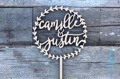 """Circle wreath with personalized names. A beautiful rustic wedding cake topper for your big day! Laser cut & designed with you in mind! [ Purchase Includes ] ♡ Circle Wreath with Names Cake Topper  [ Order Instructions ] Please provide 2 names in the notes to seller"""" section during check-out for our reference  [ Dimensions ] ♡ Diameter (of wreath): 5.5 inches ♡ Stick Height: 4.5 inches  *Dimensions are approximated in inches  [ Specifications ] MADE FROM WOOD in 3/16"""" inch (0.19 inch)..."""