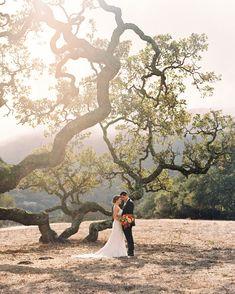 Eye-popping red and orange floral arrangements stood out against the lush mountain backdrop. #Wedding #FallWedding #WeddingIdeas #Fall #FallColors #WeddingColors #WeddingInspiration | Martha Stewart Weddings - A Vibrant Fall Wedding on a California Ranch