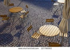 Outdoor German cafe seating with round tables and wooden chairs by Jorg Hackemann, via ShutterStock Cafe Seating, Public Seating, Outdoor Seating Areas, Lounge Seating, Garden Seating, Storage Bench Seating, Banquette Seating, Seating Plans, Courtyard Cafe
