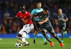 Eric Bailly of Manchester United and Eduardo Salvio of Benfica battle for the ball during the UEFA Champions League group A match between Manchester...