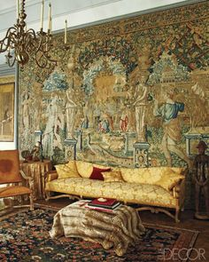 Chateau de Fleury drawing room.  17th-century Flemish tapestry, Regency style sofa and chair. Home of Charles de Ganay in Fleury-en-Bière, France.