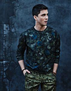 Logan Lerman (ShortList Photoshoot) Jacquard floral camo sweatshirt £440 by VALENTINO at Selfridges, selfridges.com; Camo 'Sid Pant' trousers £85 by CARHARTT, carhartt-wip.com