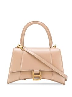 The Balenciaga Top Handle Hourglass Small Beige Calfskin Leather Shoulder Bag is a top 10 member favorite on Tradesy. Balenciaga Top, Balenciaga Handbags, Balenciaga City Bag, Leather Shoulder Bag, Leather Wallet, Cute Bags, Backpack Purse, Luxury Bags, Purses And Handbags