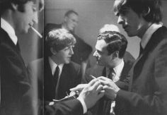 Beatles with their manager Brian Epstein