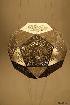 Laser cut paper hanging lamp. Sara Burgess