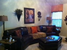 image of safari living room decorating ideas with black wood wall picture frames for elephant head