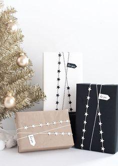 DIY- Star garland gift wrap--string, card stock, paper punch, tacky glue