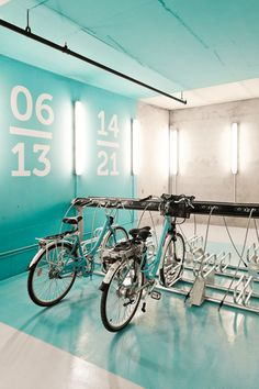 Dreamy indoor #bicycle parking lot. Love the paint color!