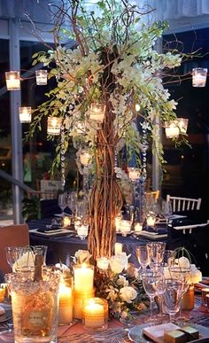 Loooove this centerpiece as our big centerpieces , but not so sure we could do that. Love how it is layered around base of centerpiece-although we couldn't do it like that because we have rectangle tables