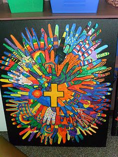 'Halo' surrounding cross made of decorated tracings of congregants' hands.