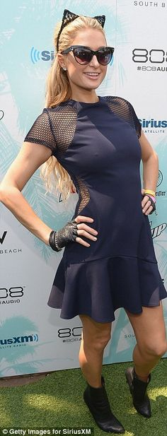 How we're used to seeing her: Paris was looking glam at a Sirius XM event in Miami last we...